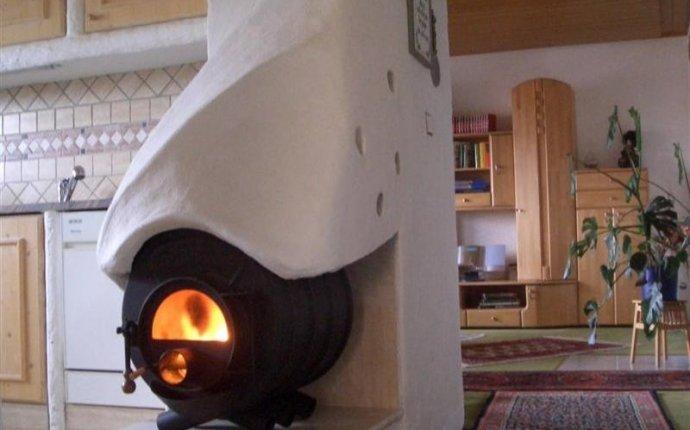 Печное отопление с водяным контуром для частного дома - полезные